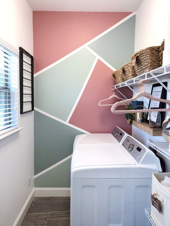 small laundry room with accent wall