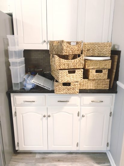 organize pantry with baskets from HomeGoods