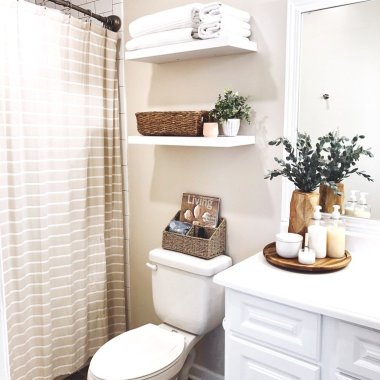 bathroom with floating shelves
