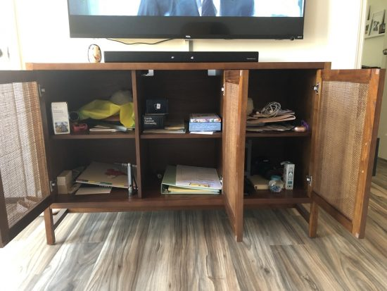 messy tv cabinet organization before