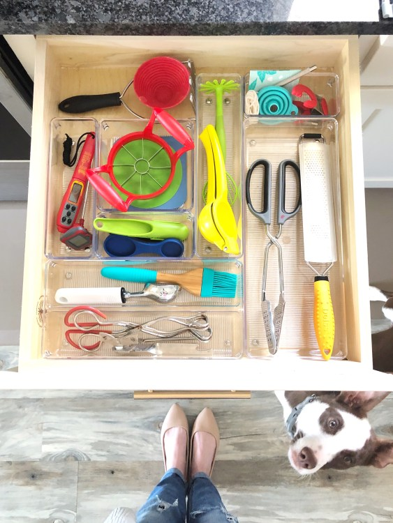 reorganized silverware drawer with miscellaneous kitchen gadgets