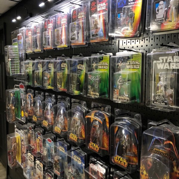 Star Wars collection display on pegboard