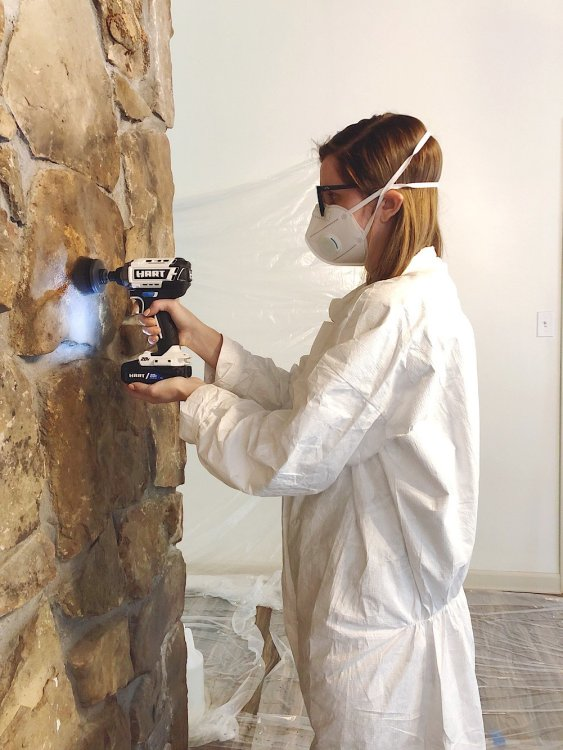 cleaning stone fireplace with drill brush