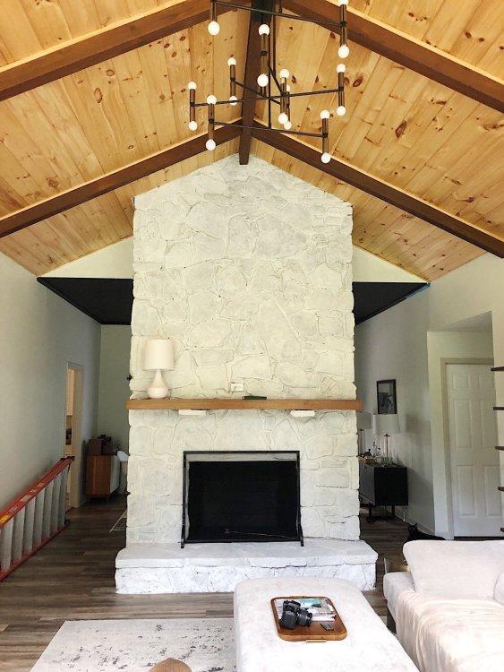 whitewashed stone fireplace