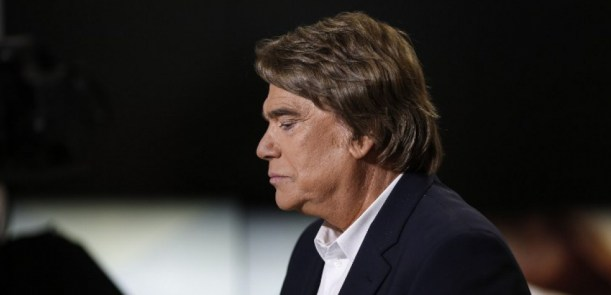 Embattled tycoon Bernard Tapie attends a broadcasted debate on French news channel iTele on July 10, 2013 in Paris, as French investigators have ordered today some of his assets seized as part of a corruption probe linked with IMF chief. Tapie has been charged with organised fraud in the probe, which relates to a 400 million euro ($525 million) state payout Tapie received in 2008 when Christine Lagarde was France's finance minister. AFP PHOTO / FRED DUFOUR / AFP / FRED DUFOUR