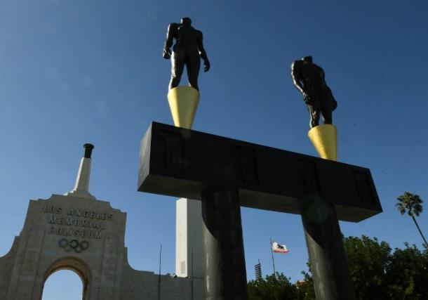 An Olympic themed monument stands beside the Los Angeles Memorial Coliseum after rival Budapest dropped its bid for the 2024 Olympics, in Los Angeles, California on February 22, 2017.