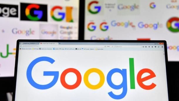 "(FILES) In this file photo taken on November 20, 2017 shows logos of US multinational technology company Google displayed on computers' screens. Google on May 4, 2018 said that people looking to place US election ads on its platform will need to show identification, and make clear who is paying.Policy changes being rolled out come as online ad 'duopoly' Google and Facebook strive to avoid being used to spread misleading or divisive ads aimed at voters.""Our work on elections goes far beyond improving policies for advertising,"" Google senior vice president Kent Walker said in a blog post. / AFP PHOTO / LOIC VENANCE"
