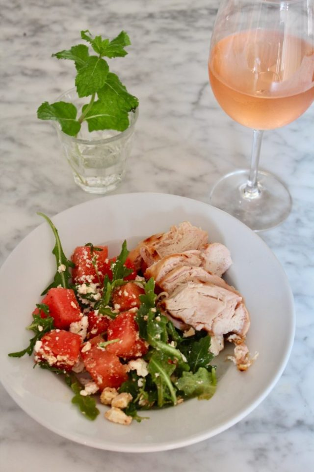 glass of rose, grilled chicken and watermelon salad