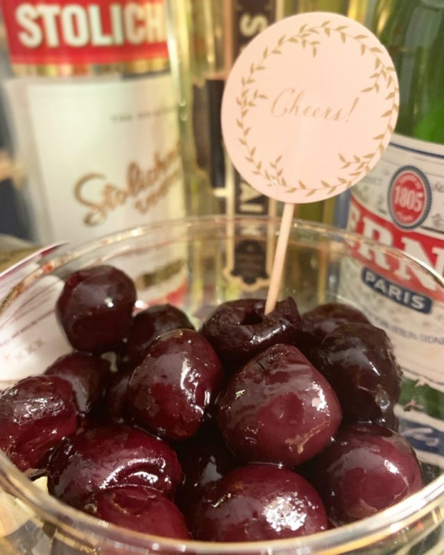 a coupe of cocktail cherries