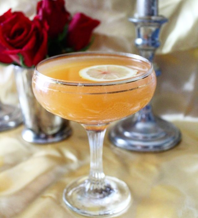 Cocktail in coupe glass on satin background