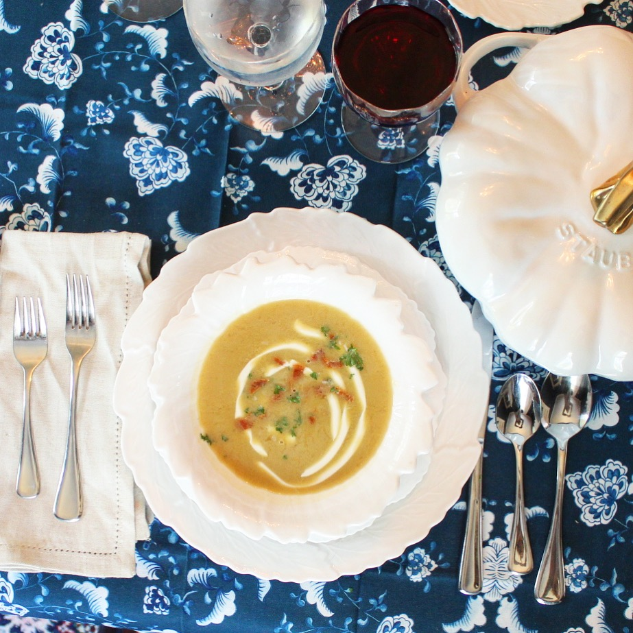 thanksgiving table set with pumpkin soup