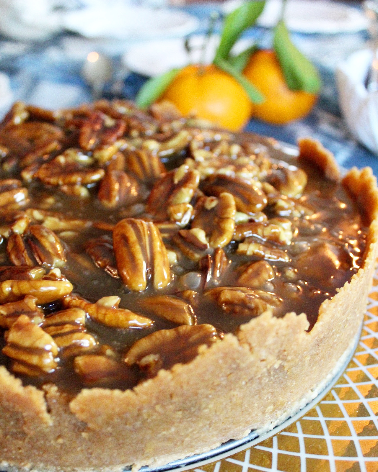 side view of pecan cheesecake with satsumas