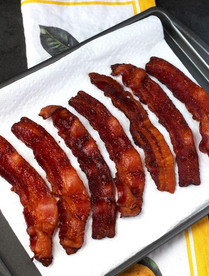 How to perfectly cook bacon in the oven view of crispy and golden brown perfectly cooked bacon laying on a paper towel lined tray ccuart Gallery