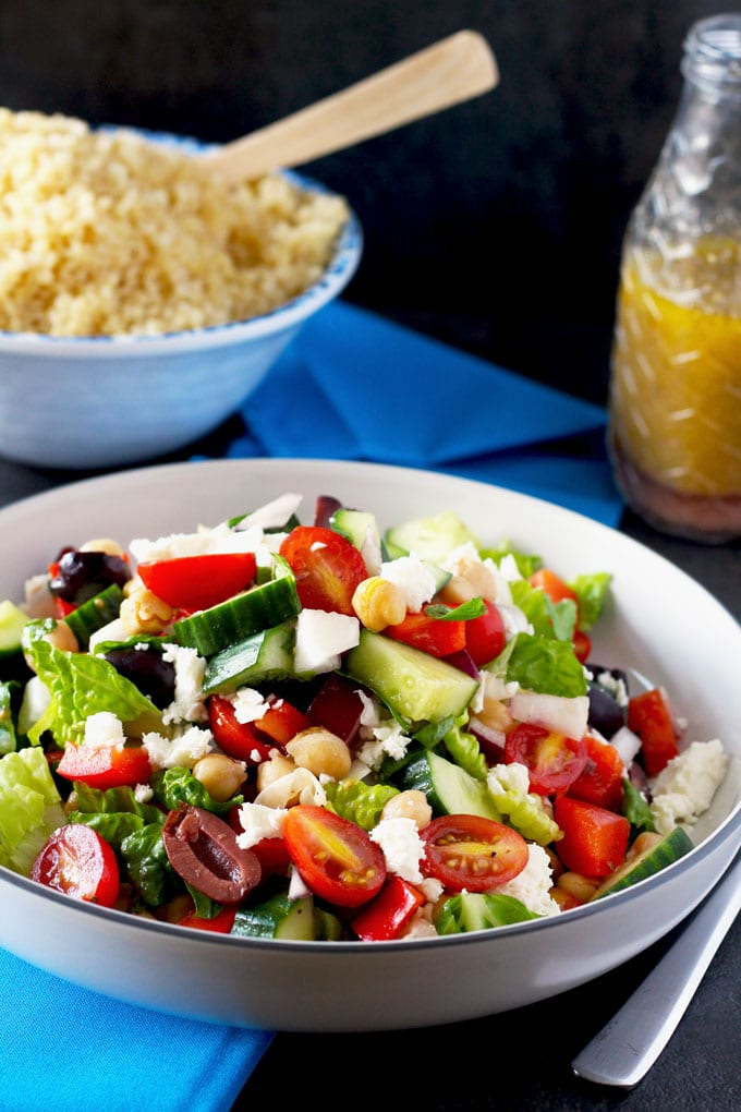 A quick, easy and healthy salad with tomatoes, cucumbers, red onions, garbanzo beans, Kalamata olives and Feta cheese tossed in a simple red wine-oregano vinaigrette. Serve it with buckwheat or quinoa for a complete and filling vegetarian meal.