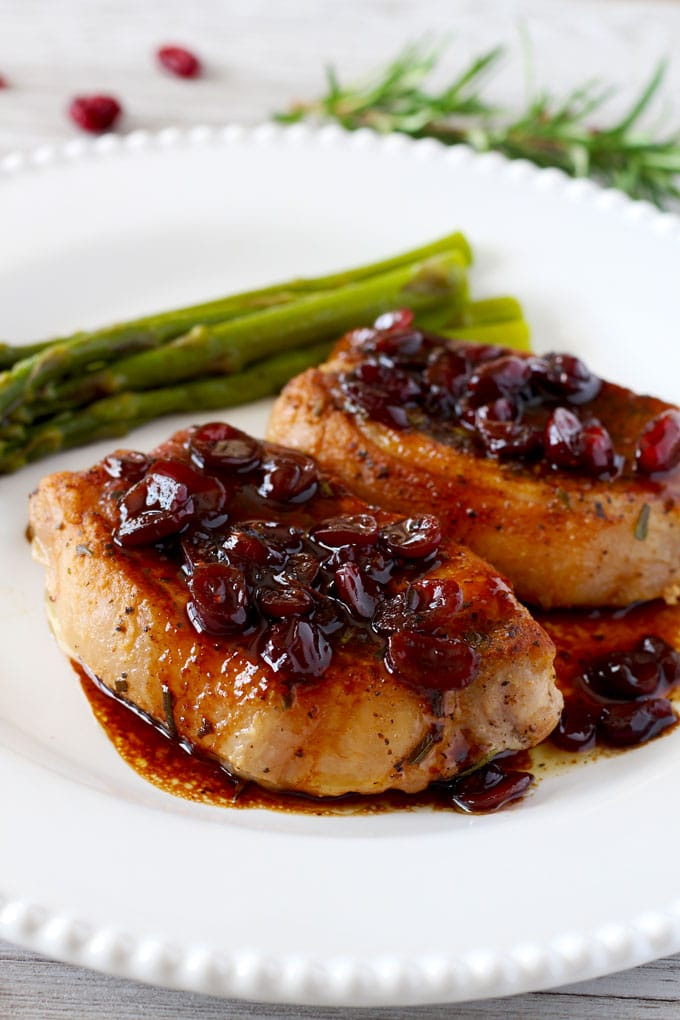 Juicy and seared to perfection Pork Chops with Port Wine and Cranberry reduction. This amazing sauce secret ingredient is the key to making restaurant style pan sauces at home!