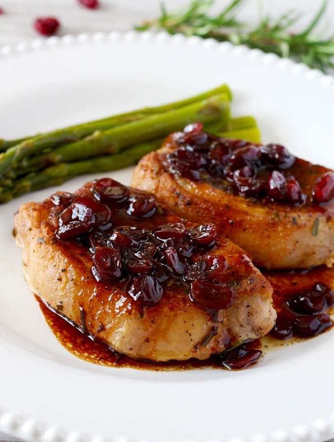 Juicy and seared to perfection Pork Chops with delicious Port Wine and Cranberry reduction. This amazing sauce secret ingredient is the key to making restaurant style pan sauces at home!