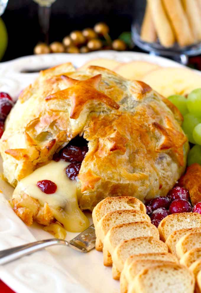 Baked Brie with Cranberries appetizer served on a white platter
