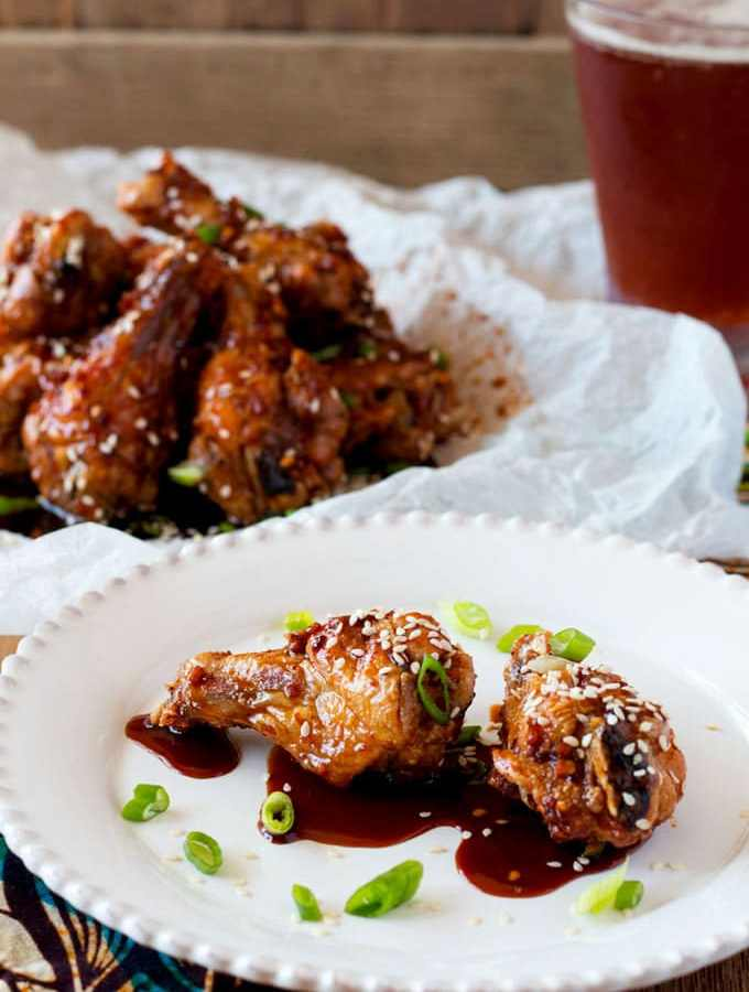 Foolproof Oven Baked Sweet and Spicy Asian Chicken Wings are extra crispy, a little sticky, deliciously sweet and a lot spicy!