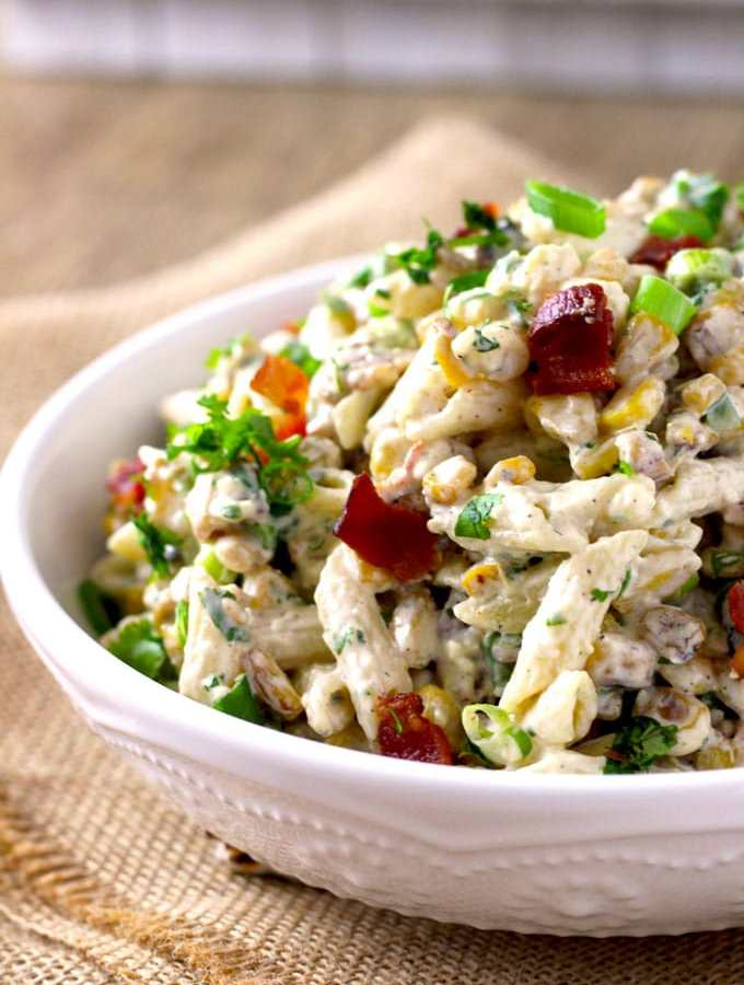 Nutty, smoky a little tart and super creamy this Mexican Street Corn Pasta Salad has all the great flavors of delicious Mexican Street Corn. Easy to make and incredibly flavorful, this is the ideal dish to make for your next gathering.