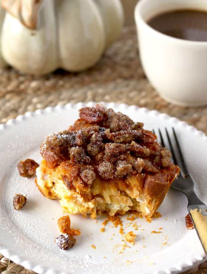 This Stuffed Pumpkin French Toast Bake is full of flavor! Sweet cream cheese filling and a crunchy pecan topping make it spectacular. The perfect breakfast to serve to family or a large crowd!