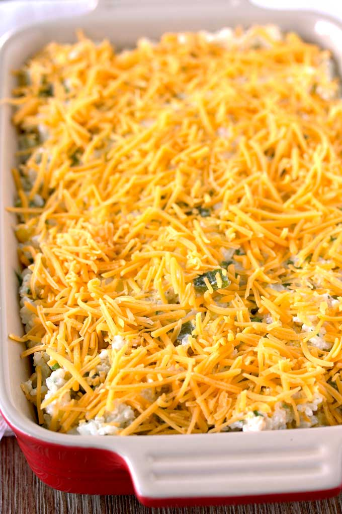 This Mexican Green Chile Rice Casserole is creamy, cheesy and irresistible. Baked with Corn, Roasted Chile Peppers, Sour Cream and Cheese, this is the perfect make-ahead side dish!