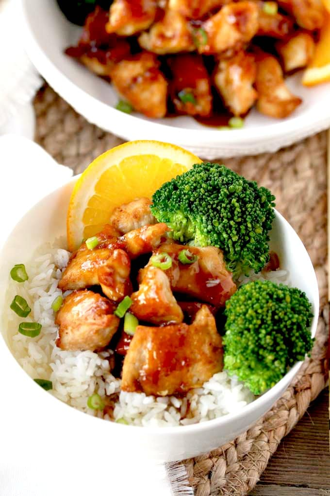 Chinese Chicken with Orange Glaze served in a bowl over white rice