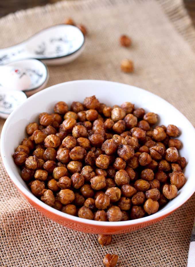 Pictured here is a small bowl filled with crispy seasoned oven roasted garbanzo beans.