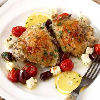 Greek Lemon Oven Roasted Chicken Thighs are quick and easy to make. Bone in chicken thighs are quickly marinated and baked with Kalamata olives, tomatoes and Feta cheese until juicy on the inside and crispy on the outside. I am sure this simple chicken thigh recipe will become a new favorite!