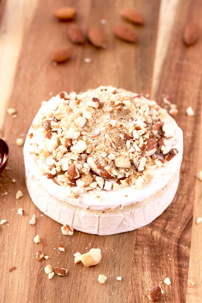 Brie cheese topped with sugar and nut mixture.