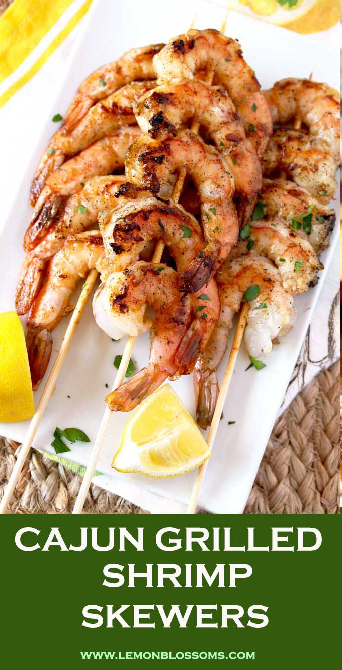 These Grilled Shrimp Skewers are seasoned with a simple Cajun butter resulting in the most mouthwatering, succulent and delicious grilled shrimp. An easy appetizer or dinner recipe guaranteed to become a favorite! #grilledshrimp #healthy #cajun #easy #recipe #kabobs #BBQ