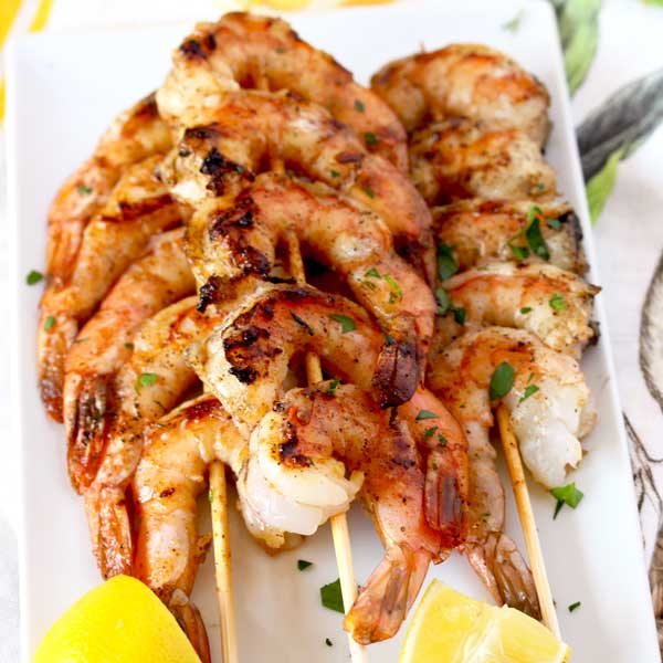 These Grilled Shrimp Skewers are seasoned with a simple Cajun butter resulting in the most mouthwatering, succulent and delicious grilled shrimp. An easy appetizer or dinner recipe guaranteed to become a favorite!