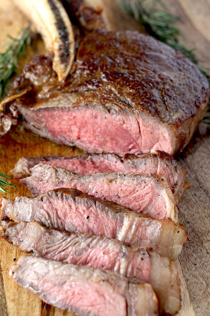 Pictured here a pan seared rib eye thinly sliced