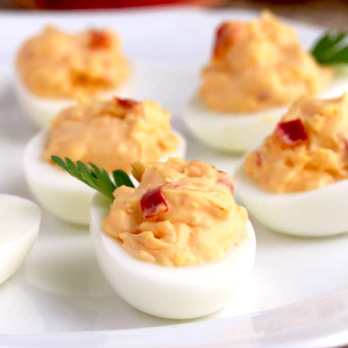 These Pimento Cheese Deviled Eggs are creamy, tasty and easy to make. A fun and delicious twist on a classic recipe and the perfect appetizer for any occasion!