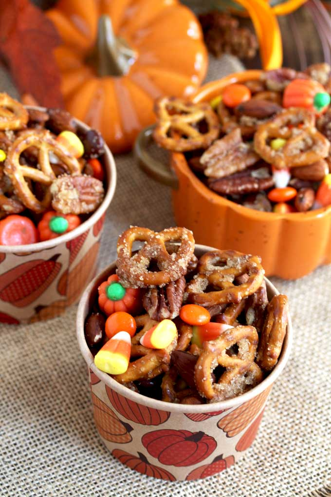 Party paper cups filled with pumpkin spice snack mix