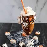 Vanilla Halloween Freak shake on a dark surface