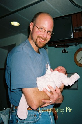 Ed holding Lily at the hospital
