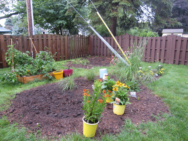My garden now, with some perennials I bought on sale that still need to be planted!