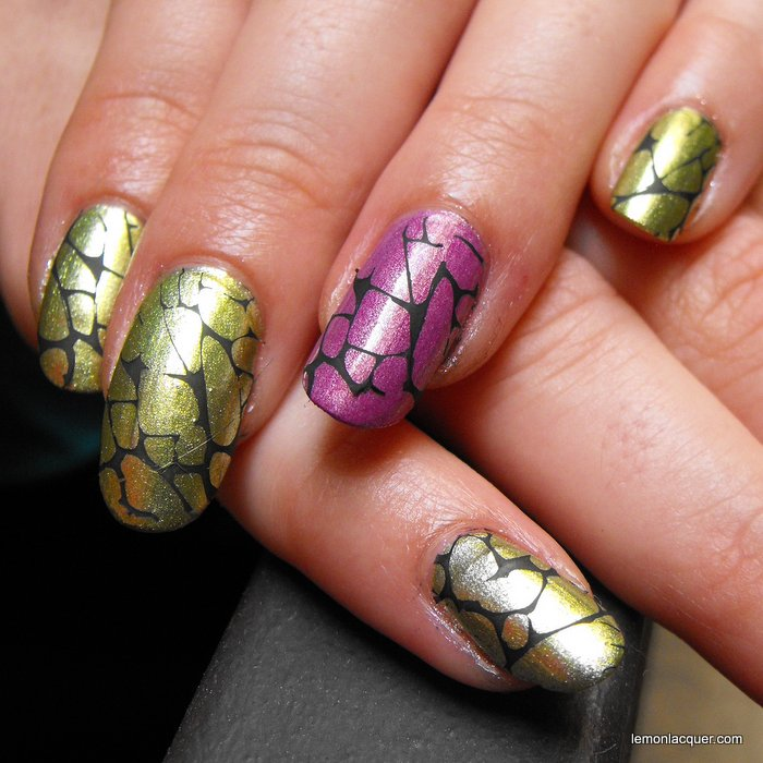 close-up on stamping over green and purple nails