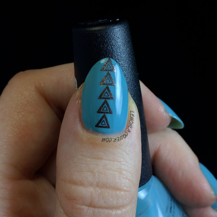 turquoise nail art with arrows, thumb