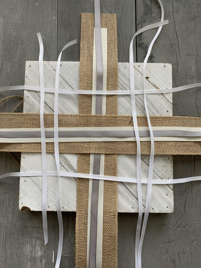 ribbon laid on top of wood board DIY wall decor