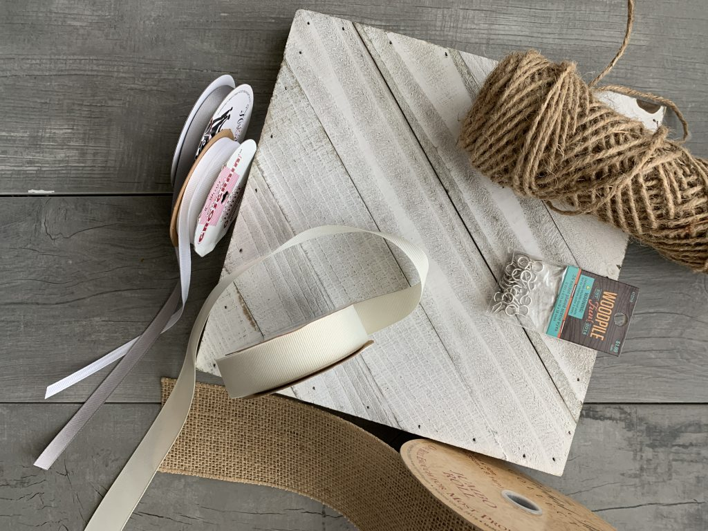 jute, screws burlap and white ribbon with wood board for winter wall decor