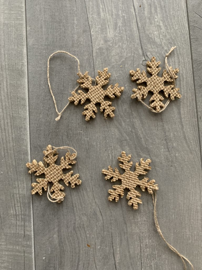 close up of burlap snowflakes for DIY winter wall decor