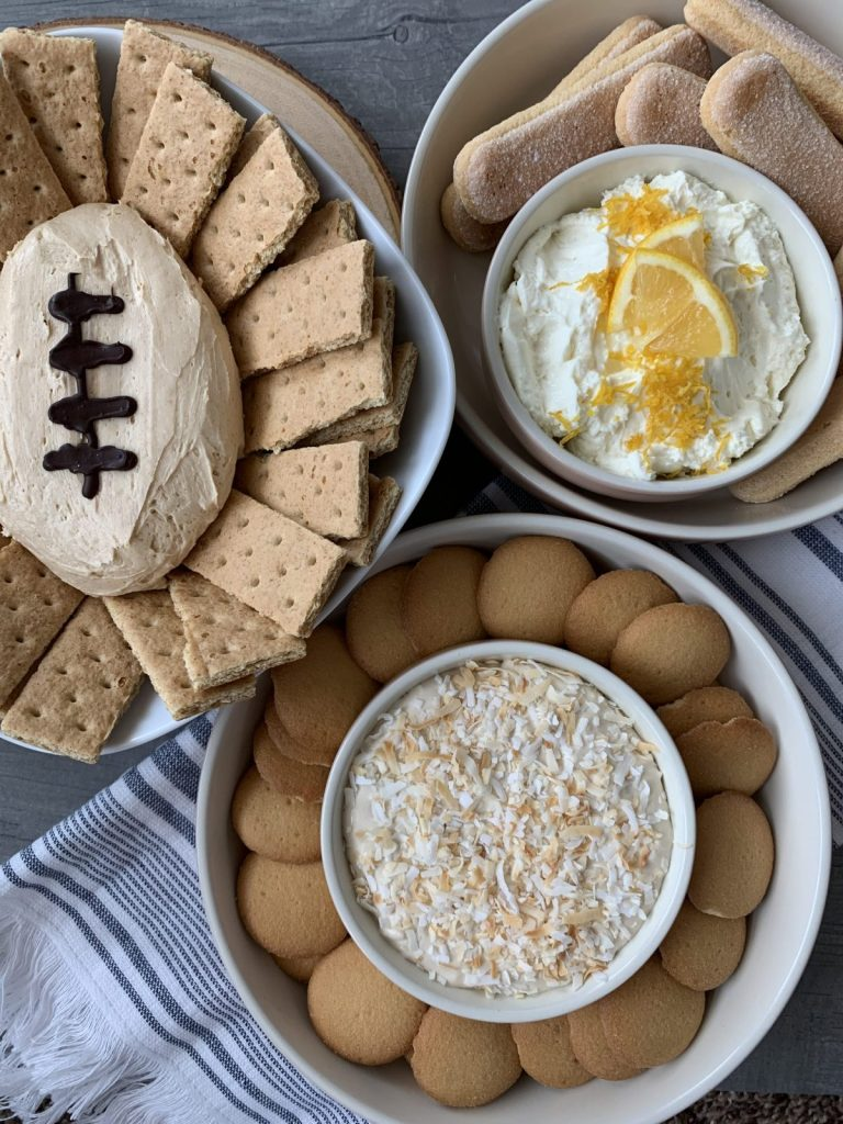 cheesecake dips with sweet chips in bowls with football chocolate drizzle