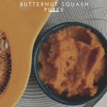 butternut puree and squash cut in half on wood plate
