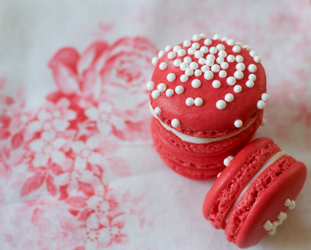 Red Macarons on Roses