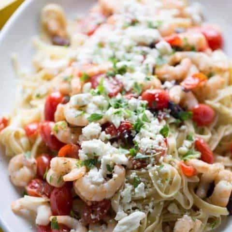 Greek style shrimp scamp with lots of fresh tomatoes, kalamata olives and feta cheese. lemonsforlulu.com