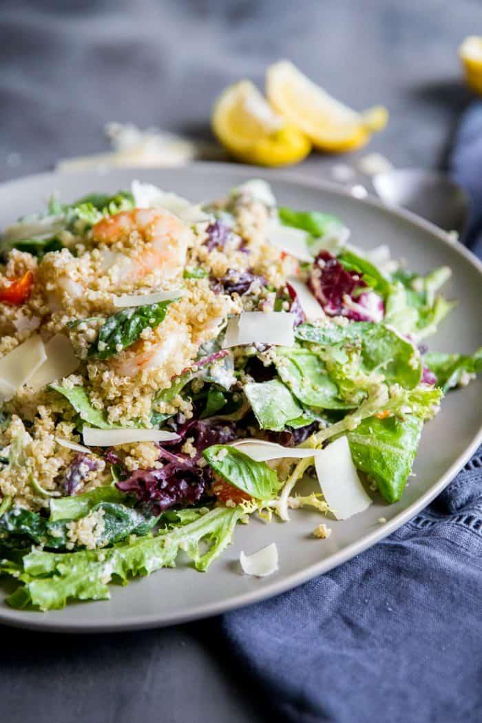 shrimp caesar salad with lemon in back