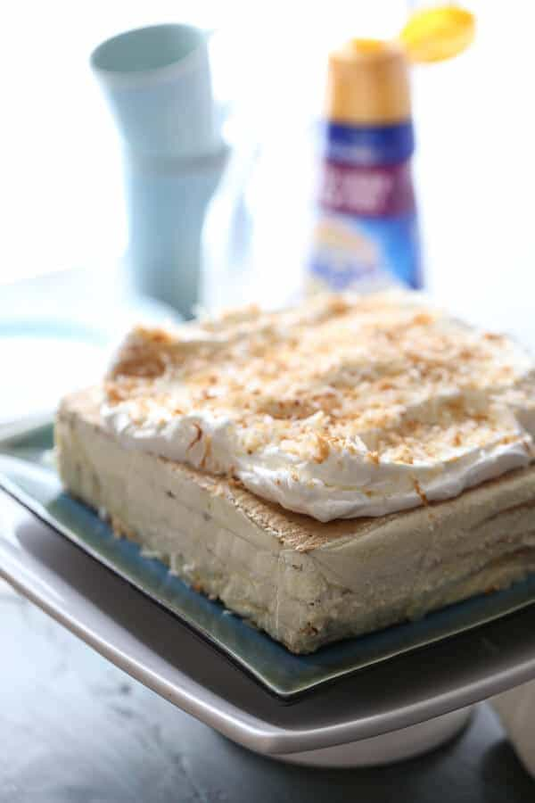 This vanilla coconut ice bake cake is such an easy no-bake treat! It's rich and creamy too! lemonsforlulu.com #IDelight @InDelight