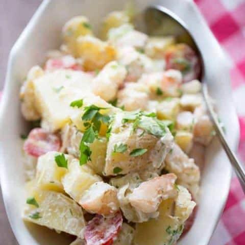 Grilled shrimp and grilled potatoes lend a smokey flavor to this easy Po Boy potato salad recipe! lemonsforlulu.com