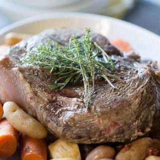 This slow cooker pot roast is going to knock your socks off! Tender beef and simple vegetables are cooked low and slow and are ready when you are! lemonsforlulu.com